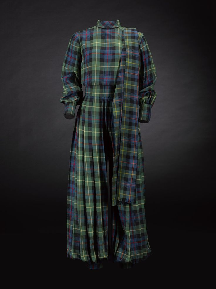 Woman's top or blouse, part of an ensemble with A.1994.1036 B & C, in fine woven wool of Farquharson tartan, chequered with crossing stripes of dark green, dark blue, narrow red and narrow yellow, high neckline with short standing collar and centre back fastening, full-length sleeves, cuffs fastening with four buttons, belonged to Frances Strickland Lovell Oldham, also known as Frances Farquharson of Invercauld: Scottish, c. 1950s
