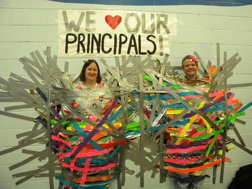 Glenview: The Henking Hoffman PTA held a Pancake Breakfast on Saturday, Feb. 9 at Hoffman School. At the event, principal Dr. Ivy Sukenik of of Henking and Mr. Mark Walther of Hoffman were suspended to the wall, by the students, using duct tape.