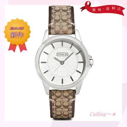 関税,送料込!COACH☆Classic signature watch☆腕時計☆シンプルな文字盤の真ん中がコーチのマークになっていてとってもキュートな時計☆ バンド部分もコーチのマークになっていて一際目を惹くラグジュアリーなアイテムです☆