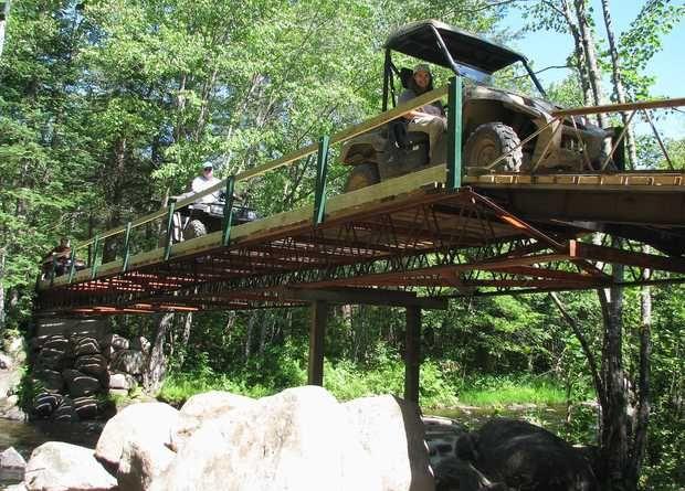 atv clubs in maine | ATV club builds new 134-foot bridge over Little Ellis River | Sun ...