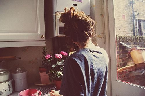 Looks like pretty much the perfect weekend afternoon: hair in a sloppy bun, in pjs, staring at fresh flowers.