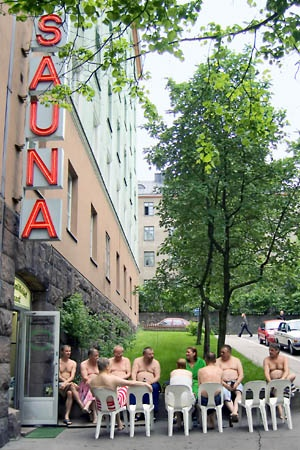 Men sitting and cooling down after sauna, outside one of the public saunas in Helsinki