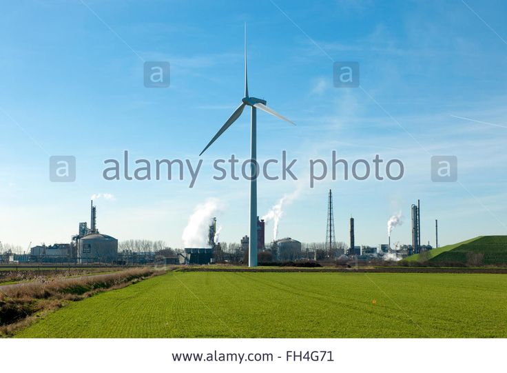 Wind Turbine On A Green Field With Industrial Yara Area In The Stock Photo, Picture And Royalty Free Image. Pic. 96601541