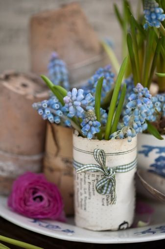 Vessels for flowers wrapped in vintage book paper or even newspaper.  Inexpensive and very effective.