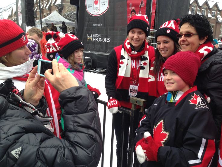 Canadian women's hockey team posing with fans in Banff