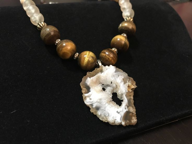 A personal favorite from my Etsy shop https://www.etsy.com/ca/listing/526419520/geode-pendant-necklace-with-tiger-eye