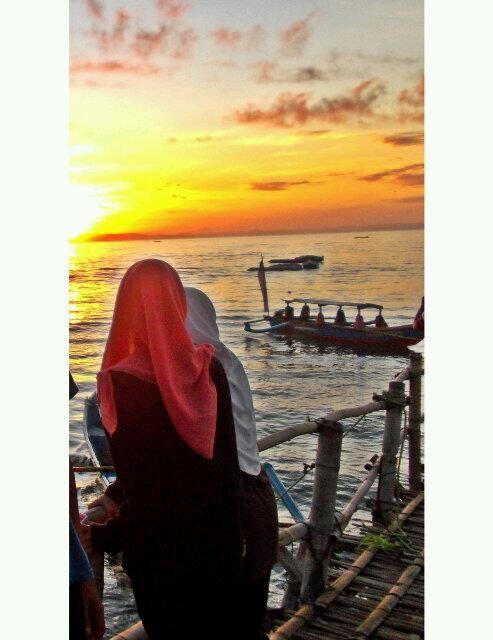 melihat matahari terbit, hangatt di pantai timur....