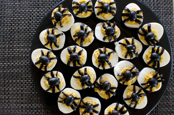 Halloween Deviled Eggs     6 Eggs, hard boiled and peeled and sliced in half  1/4 c. Mayonnaise  1 1/2 tsp. Sweet Pick Relish  1 1/2 tsp. Yellow Mustard  1/4 tsp. Garlic Powder  1/4 tsp. Smoked Paprika  Pinch of salt  1 can of pitted black olives    Recipe:  1. Mash the egg yolks, mayonnaise, relish, mustard, garlic, paprika and salt  2. Scoop even amounts of filling into each egg half  3. Cut black olives in half for the spider body  4. Slice half olives longwise for 3 to 4 legs