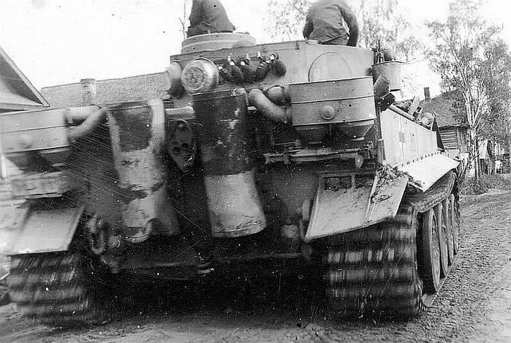 Note: Flask and two plates are hanging on the rear of the Tiger