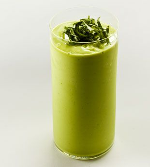 Avocado Basil Smoothie | 1 ripe avocado, halved and pitted | 1 1/4 cups whole milk  | 1 1/2 tablespoons fresh lime juice | 1 tablespoon sugar | 1 tablespoon fresh basil, chopped | 1 cup ice | Basil, thinly sliced | Scoop the flesh from the avocado into a blender. Add milk, lime juice, sugar, and chopped basil; purée. Add ice; purée until smooth.