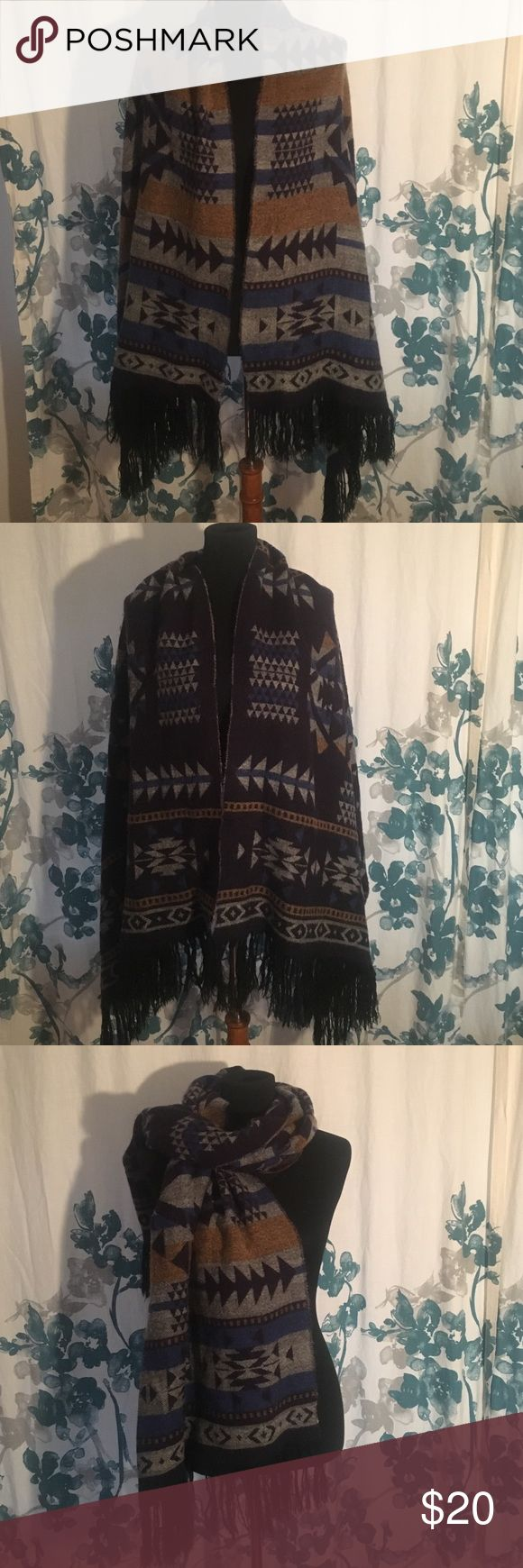 Reversible, warm scarf Why eat up closet space with several scarves when this one is a two for one deal!!! Yellow, grey, shades of blue with black fringe on the bottom. Aztec designs throughout. This scarf does not fail to impress!! Small imperfection depicted in picture 4. Not noticeable when worn! Accessories Scarves & Wraps