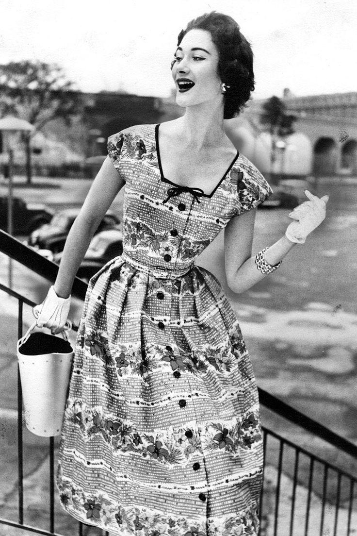 Truly Vintage Street Style  - HarpersBAZAAR.com  Love her bucket bag and look that that teeny-tiny waist!