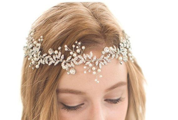 Elegant and sparkling bridal head piece  Can be worn in various ways  Features a…