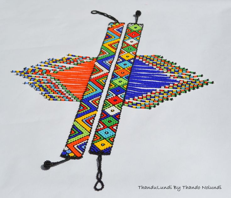 A traditional Zulu/Ndebele choker necklace with symmetrical geometric designs and a tassel drop focal point. A statement piece and very eye catching necklace that can be worn stylishly with most outfits.Intricately handcrafted in South Africa using delicate glass beads. Length between approx. 30cm - 35cm Beaded 3 extension loop and ball fastening Note: each choker is unique and handmade individually, so the geometric designs will vary.