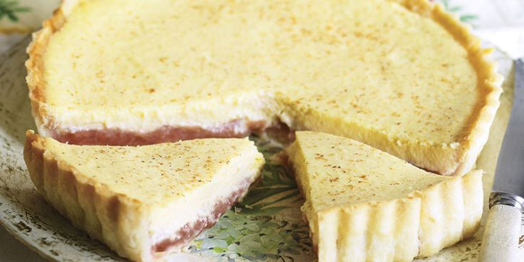 Silky Rhubarb And Custard Tart: Sharp fruit paired with silky cream are a match made in heaven in this beautiful custard tart recipe. It's easy to make but looks seriously impressive!