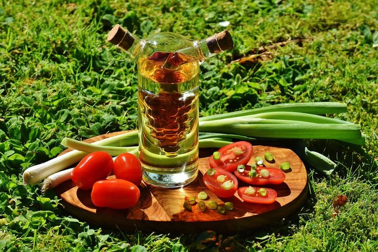 Green Onion Spring Near Clear Glass Container  #blur  #bottle  #cherry #tomatoes  #choppingboard  close-up  #color  #cook  #cork  #cork lid  #focus  #food  #fresh  #freshness  #fruit  #garden  #glass  #grass  #health  #healthy  #ingredients  #leaf  #leek  #nutrition  #oil  #shadow  #spring #onions  #tomato  #tomatoes
