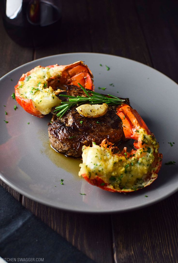 A super easy surf and turf recipe made with buttered, baked lobster tails and a pan-seared NY strip steak cut in two.