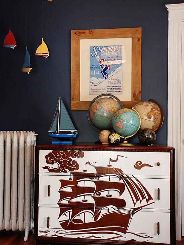 It's refreshing to see a kid room with personality. Unusual furniture pieces or artwork tell a story. Children always want to feel like they are on an adventure, so why not bring it into their space? This old wooden dresser was upcycled with a reverse stencil treatment to create a showcase piece that brings the room's travel theme to life. Photo courtesy of ProjectNursery.com: Pirates Ships, Old Dressers, Boys Bedrooms, Paintings Dressers, Big Boys, Neat Ideas, Little Boys Rooms, Boys Rooms Design, Kids Rooms