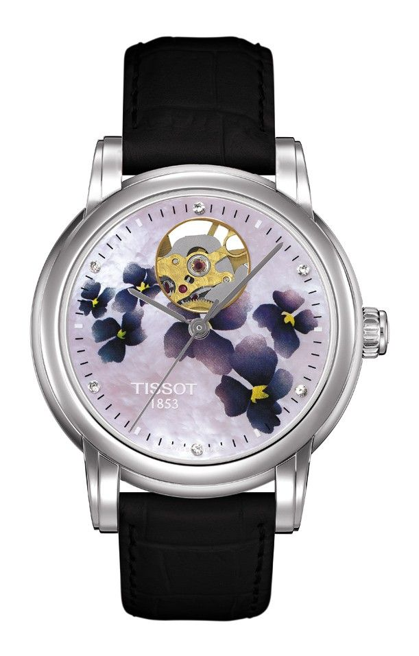 The Tissot Lady Hearts are filled with feminine charm – inside and out. The inner beauty, a fine automatic movement, is visible through a window on the lovely dial at the magical hour of twelve. Femininity finds further expression through details such as sparkling diamonds or studs on some models and elegant straps. These are perfect watches for graceful ladies willing to reveal a secret to those close to them... This model features a mother-of-pearl dial with a lilac floral motif. Six Top…