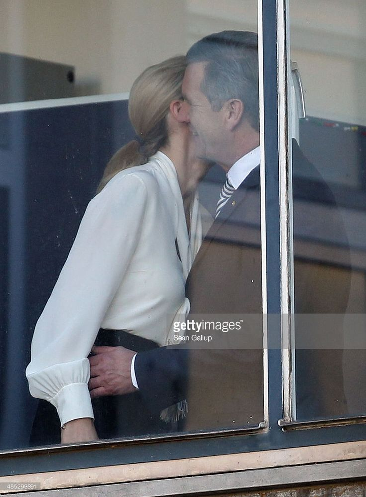 Former German First Lady Bettina Wulff embraces her estranged husband, former German President Christian Wulff, upon her arrival to testify in his case at the Landgericht Hannover courthouse on December 12, 2013 in Hanover, Germany. Wulff is accused of allowing film producer David Groenewold to pay for a Munich hotel booking while Wulff was governor of Lower Saxony in exchange for Wulff's support in promoting one of Groenewold's films. Wulff is the first post-World War II German president to…