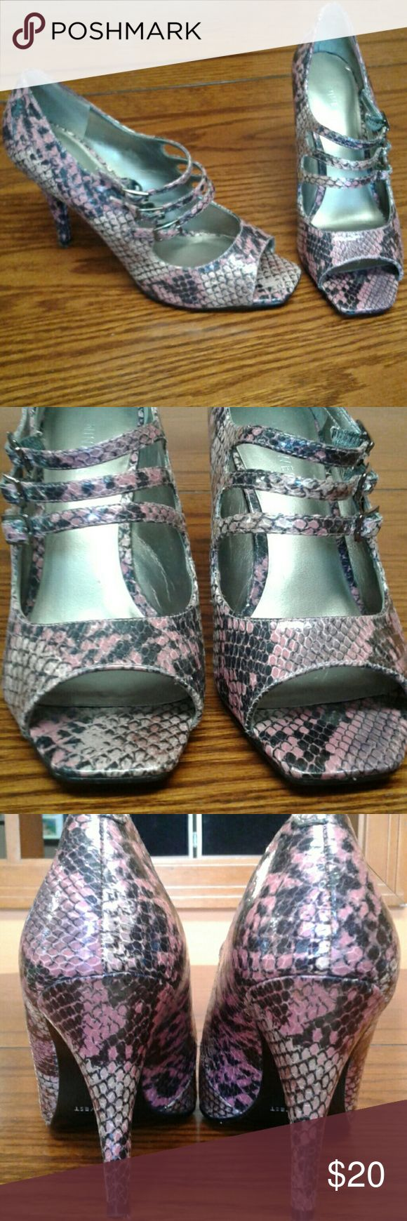 "Nine West heels Snakeskin print Nine West heels with shades of black, pink, purple and tan. Cute strap details. Approximately 4"" heel. Nine West Shoes Heels"