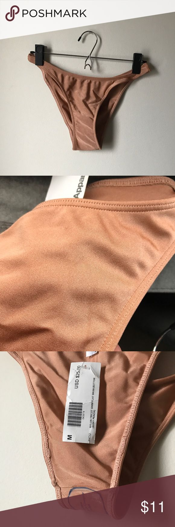 American apparel peach bathing suit bottom American apparel bikini bottom in peach. New with tags and sanitary lining. High cut keeps the leg long. Color is trendy and neutral. Wear with solid black, a print, or a similar tone for mono-chromatic look. American Apparel Swim Bikinis