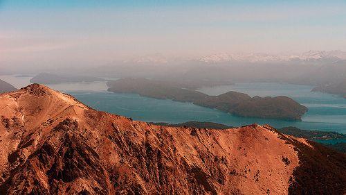 "Isla Victoria (Victory Island) on Nahuel Huapi lake (765 m) under an ash cloud from Puyehue volcano. Refugio Lynch (1930 m), Cerro Catedral, Bariloche, Río Negro, Argentina, 2011-12-06 11:46."""