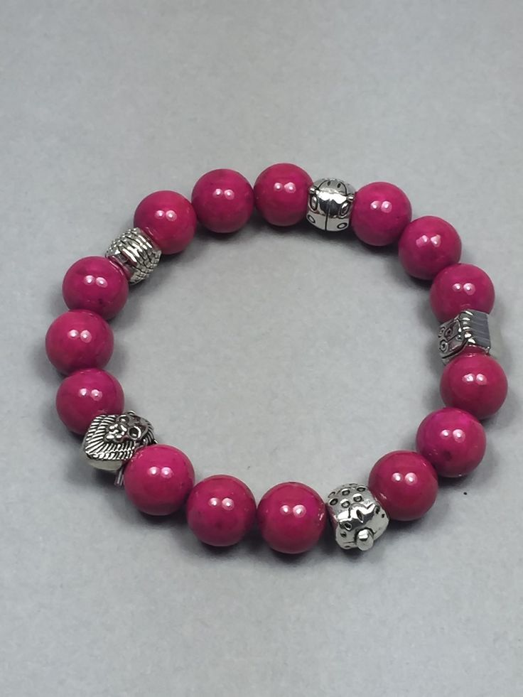 This stretch bracelet is handcrafted using rose riverstone beads and silver spacer beads. The riverstone beads are 10mm in diameter. Measure: 7 inches *************************************************