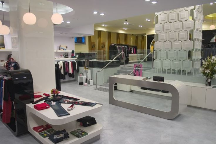 A clothing store featuring #seamless stone floors in a #concrete styled look. Not to be mistaken with #microtopping.
