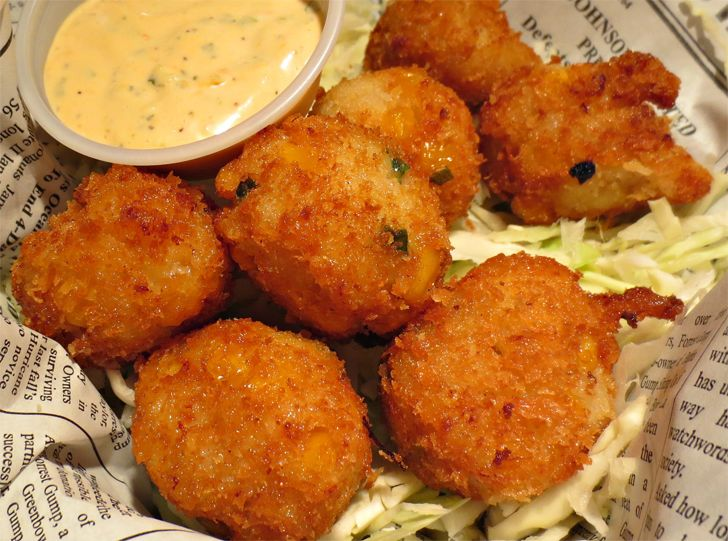 Bubba Gump Shrimp Co. Seafood Hush Pups Recipe. Ingredients: ½ cup mayonnaise, 2 tablespoons milk, 2 teaspoons finely minced cilantro, 2 teaspoons finely...