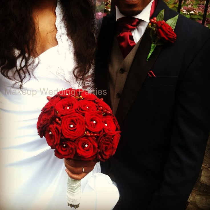 Red roses bridal bouquet and Groom's button hole