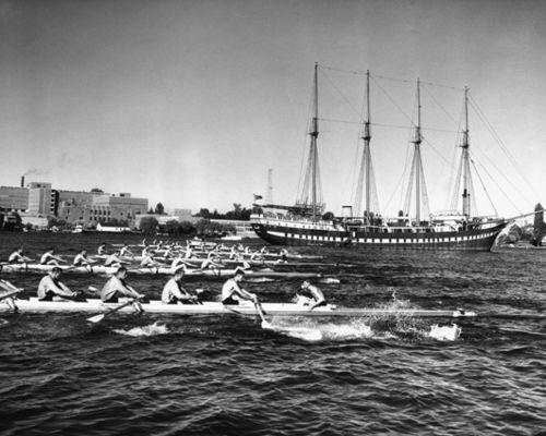 University of Washington Crew Team Rowing Near Yacht Fantome, Seattle, 1954. Photographer Josef Scaylea