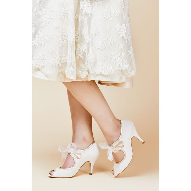 Ivory suede peep toe with art deco inspired detail and organza ribbon tie.