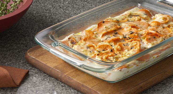 Sweet Potato Gratin with Gruyere - the sweet potatoes and tangy Gruyere cheese mingle with fresh thyme and a garlic cream sauce to create a dish that's truly something special.