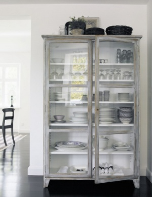 love the cabinet with white walls and dark floors....