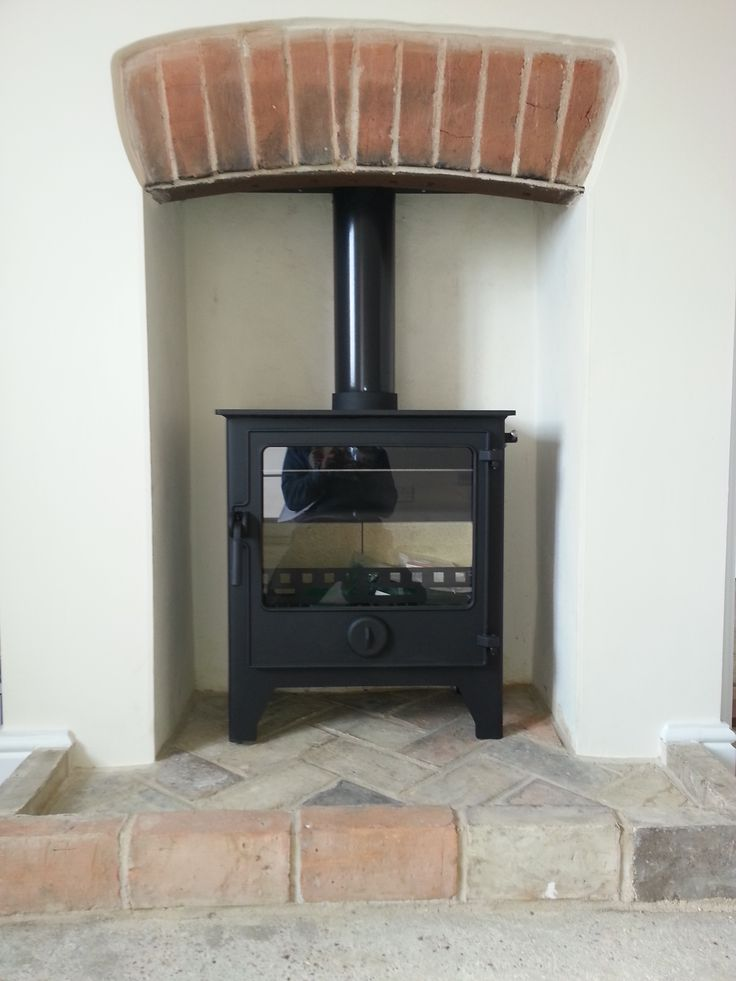 A Dean Forge Dartmoor W5 stove which perfectly fits into this fire place.
