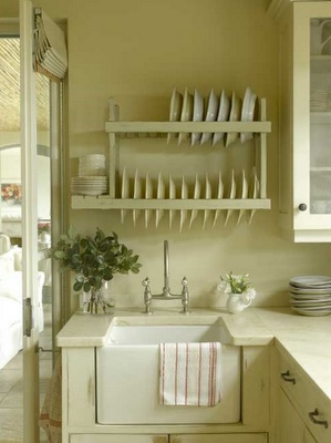 Plate rack above the sink, enjoying this one as well.
