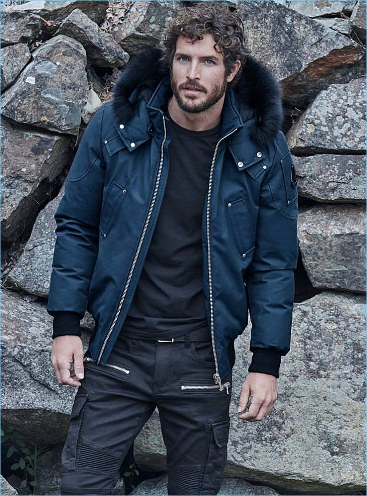 Model Justice Joslin wears a Moose Knuckles bomber jacket with a LE 31 t-shirt and cargo jeans.