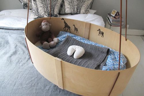 a bassinet that hangs above the bed... awesome! you can rock them a little as you're also going to bed.. nice <3