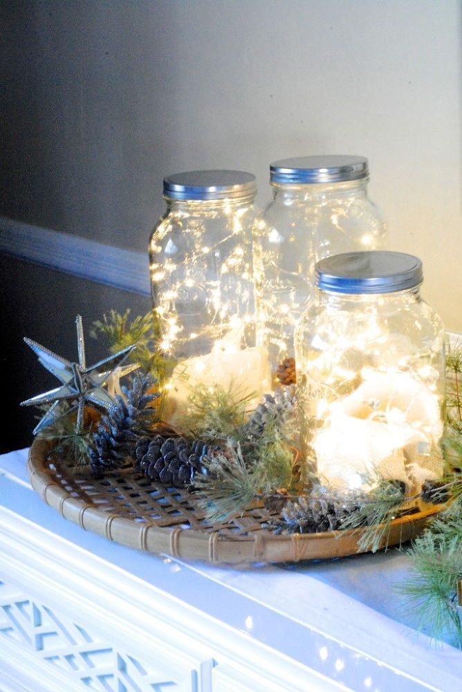 Simply fill a Mason jar with a bunch of string lights, then cluster together on a mantel or entryway table. Beautiful!