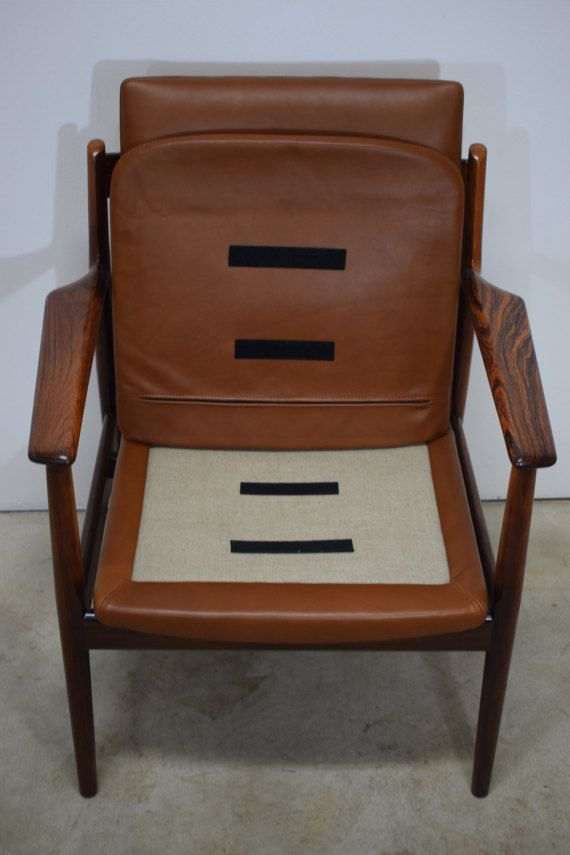 Danish vintage rosewood armchair with Elegance aniline leather. Design by Arne Vodder. Produced by Sibast Furniture, The chair has been upholstred in brown Elegance aniline leather by Danish AP Møbelpolstring in November 2016. The rosewood frame has a beautiful grain structure and is newly refinished. 86 x 64 x 69 cm ( 33.8 x 25.2 x 27.1)  Small traces of wear.  Shipping: International shipping available. Contact for a shipping quote to countries not priced in this listing, Please also…