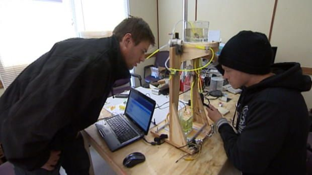 CBC News. Rylan Grayston, a 28 year old Saskatchewan man, has developed the first widely affordable 3d printer. Priced at $100, the 3d printer uses audio files to move and  vibrate electromagnetic mirror and laser beams, a vastly different system than the more expensive models. Kalina E.
