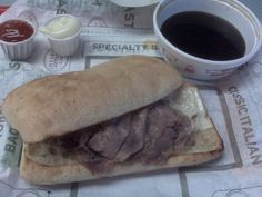 Arby's French Dip and Swiss  2 large onions, cut into 1/4-inch slices 1/4 cup butter, cubed 1 (3-4 lb.) beef rump roast or bottom round roast 5 cups water 1/2 cup soy sauce 1 envelope onion soup mix 1 1/2 teaspoons browning sauce, optional 1 garlic clove, minced 12 to 14 French rolls, split 1 cup (4 ounces) shredded Swiss cheese