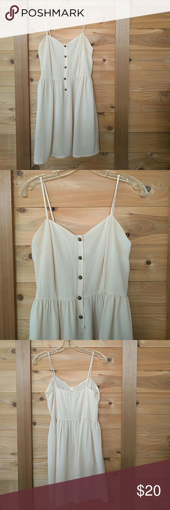 Simple is Best Cream Summer Dress w Brass Buttons Audrey 3+1 brand. Fiber content is crepe polyester. Very nicely lined. On the smaller side of medium, probably a medium junior. Audrey 3+1 Dresses Mini