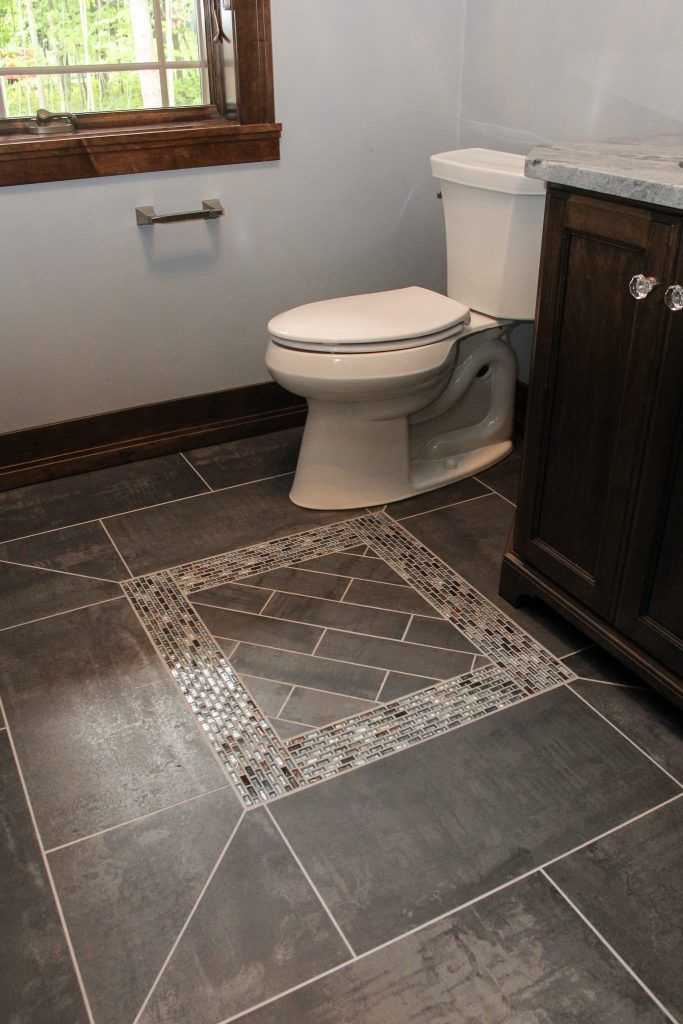 Dark Grey Tile Flooring With Dark Colors In The Accent With