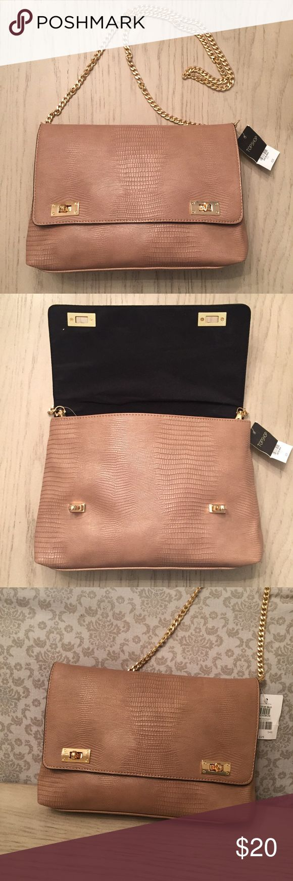 NWT topshop purse- Tan with gold chain and clasps This TOPSHOP purse, purchased at Nordstrom is NWT, sophisticated and adorable.  Black interior. Simple and chic, slightly larger than a clutch. Topshop Bags