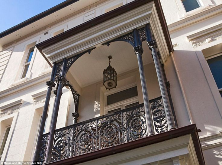 Castiron columns and lacy balconies decorate the outside