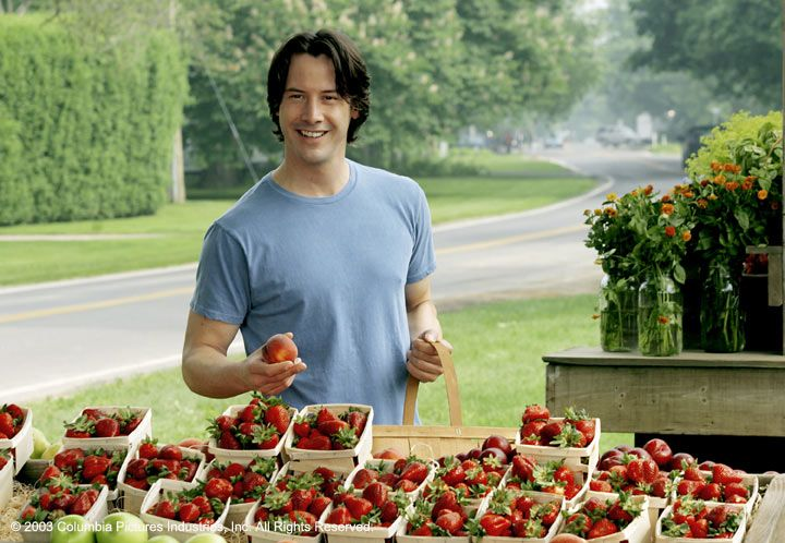 Keanu Reeves buying strawberries at a farm stand:)