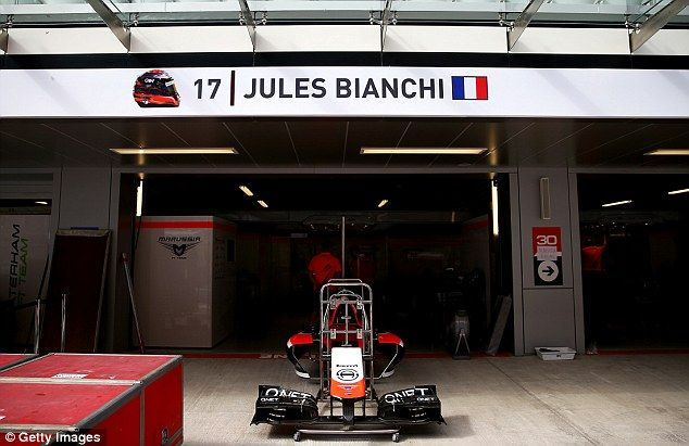 Jules Bianchi's name takes place on his side of the Marussia garage ahead of the Russian G...