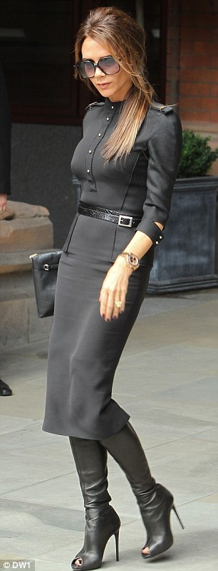 Victoria Beckham looking military chic in grey